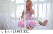 Купить «Baby playing to hide and seek», видеоролик № 29681532, снято 25 ноября 2011 г. (c) Wavebreak Media / Фотобанк Лори