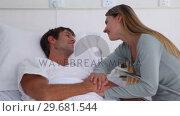 Купить «Smiling woman holding her husbands hand», видеоролик № 29681544, снято 25 ноября 2011 г. (c) Wavebreak Media / Фотобанк Лори