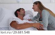 Купить «Sick man kissing his wife», видеоролик № 29681548, снято 25 ноября 2011 г. (c) Wavebreak Media / Фотобанк Лори