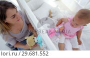 Купить «Mother playing with her baby with dolls», видеоролик № 29681552, снято 25 ноября 2011 г. (c) Wavebreak Media / Фотобанк Лори