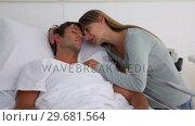 Купить «Woman embracing her unconscious husband», видеоролик № 29681564, снято 25 ноября 2011 г. (c) Wavebreak Media / Фотобанк Лори