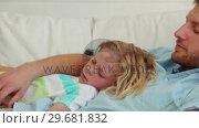 Купить «Father and son sleeping together», видеоролик № 29681832, снято 25 ноября 2011 г. (c) Wavebreak Media / Фотобанк Лори