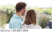 Купить «Brunette haired couple looking into the distance», видеоролик № 29681964, снято 25 ноября 2011 г. (c) Wavebreak Media / Фотобанк Лори