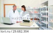 Купить «Pharmacists talking», видеоролик № 29682304, снято 26 апреля 2012 г. (c) Wavebreak Media / Фотобанк Лори