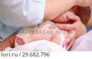Купить «Mother breastfeeding a baby», видеоролик № 29682796, снято 27 апреля 2012 г. (c) Wavebreak Media / Фотобанк Лори
