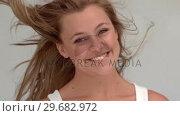 Купить «Happy woman shaking her hair », видеоролик № 29682972, снято 22 августа 2012 г. (c) Wavebreak Media / Фотобанк Лори