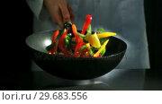 Купить «Chef tossing wok of sliced peppers », видеоролик № 29683556, снято 2 марта 2012 г. (c) Wavebreak Media / Фотобанк Лори