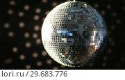 Купить «Shiny disco ball turning», видеоролик № 29683776, снято 18 января 2013 г. (c) Wavebreak Media / Фотобанк Лори