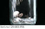 Купить «Many coins pouring into glass jar close up», видеоролик № 29683956, снято 4 февраля 2013 г. (c) Wavebreak Media / Фотобанк Лори
