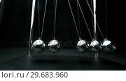 Купить «Perpetual motion of newtons cradle», видеоролик № 29683960, снято 6 февраля 2013 г. (c) Wavebreak Media / Фотобанк Лори