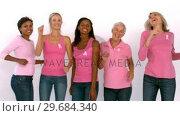 Купить «Women wearing pink ribbon against cancer dancing», видеоролик № 29684340, снято 30 марта 2013 г. (c) Wavebreak Media / Фотобанк Лори