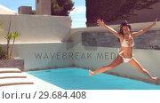 Купить «Pretty woman jumping in swimming pool», видеоролик № 29684408, снято 25 марта 2013 г. (c) Wavebreak Media / Фотобанк Лори