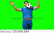 Купить «Handsome man controlling a football with his chest on green screen », видеоролик № 29684884, снято 7 апреля 2013 г. (c) Wavebreak Media / Фотобанк Лори