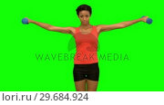 Купить «Pretty woman lifting dumbbells on green screen», видеоролик № 29684924, снято 7 апреля 2013 г. (c) Wavebreak Media / Фотобанк Лори