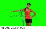 Купить «Woman working out with a hula hoop on green screen», видеоролик № 29684928, снято 7 апреля 2013 г. (c) Wavebreak Media / Фотобанк Лори