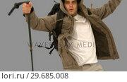 Купить «Man with a hiking stick running on grey screen», видеоролик № 29685008, снято 7 апреля 2013 г. (c) Wavebreak Media / Фотобанк Лори