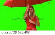 Купить «Woman holding an umbrella on green screen», видеоролик № 29685408, снято 8 апреля 2013 г. (c) Wavebreak Media / Фотобанк Лори