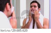 Купить «Handsome man applying shaving foam», видеоролик № 29685620, снято 2 августа 2013 г. (c) Wavebreak Media / Фотобанк Лори