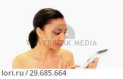 Купить «Gleeful dark haired woman using her white tablet», видеоролик № 29685664, снято 14 июня 2013 г. (c) Wavebreak Media / Фотобанк Лори