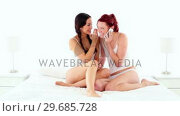Купить «Gleeful attractive woman phoning with smartphone sitting on bed», видеоролик № 29685728, снято 15 августа 2013 г. (c) Wavebreak Media / Фотобанк Лори