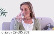 Купить «Calm woman drinking a glass of water», видеоролик № 29685808, снято 31 мая 2013 г. (c) Wavebreak Media / Фотобанк Лори