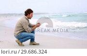 Купить «Man looking out to sea», видеоролик № 29686324, снято 10 октября 2013 г. (c) Wavebreak Media / Фотобанк Лори