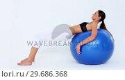 Купить «Fit woman doing pelvic lifts on blue exercise ball», видеоролик № 29686368, снято 15 октября 2013 г. (c) Wavebreak Media / Фотобанк Лори