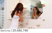 Купить «Pretty woman checking herself in the morning», видеоролик № 29686740, снято 13 декабря 2013 г. (c) Wavebreak Media / Фотобанк Лори