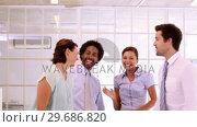 Купить «Business team high fiving together», видеоролик № 29686820, снято 19 декабря 2013 г. (c) Wavebreak Media / Фотобанк Лори