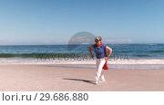 Купить «Fancy-dress mature woman dancing », видеоролик № 29686880, снято 12 ноября 2015 г. (c) Wavebreak Media / Фотобанк Лори