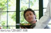 Купить «Cute couple is being waited on a glass during lunch meeting», видеоролик № 29687108, снято 23 ноября 2015 г. (c) Wavebreak Media / Фотобанк Лори