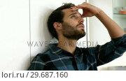 Купить «Man is standing against a wall with a sad expression on his face», видеоролик № 29687160, снято 16 декабря 2015 г. (c) Wavebreak Media / Фотобанк Лори