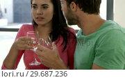 Купить «Couple are toasting together », видеоролик № 29687236, снято 16 декабря 2015 г. (c) Wavebreak Media / Фотобанк Лори