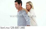 Купить «Happy man giving piggybag to woman against white background», видеоролик № 29687340, снято 3 февраля 2016 г. (c) Wavebreak Media / Фотобанк Лори