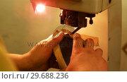Купить «Cobbler using sewing machine», видеоролик № 29688236, снято 13 апреля 2016 г. (c) Wavebreak Media / Фотобанк Лори