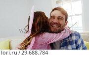 Купить «Girl dressed up in a fairy costume embracing her father», видеоролик № 29688784, снято 28 июня 2016 г. (c) Wavebreak Media / Фотобанк Лори