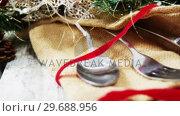 Купить «Cutlery with sack and christmas decoration», видеоролик № 29688956, снято 30 августа 2016 г. (c) Wavebreak Media / Фотобанк Лори