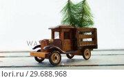 Купить «Toy tempo carrying christmas fir on wooden plank», видеоролик № 29688968, снято 30 августа 2016 г. (c) Wavebreak Media / Фотобанк Лори