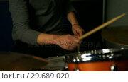 Купить «Man playing a drums», видеоролик № 29689020, снято 31 августа 2016 г. (c) Wavebreak Media / Фотобанк Лори
