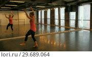 Купить «Woman practicing a tap dance», видеоролик № 29689064, снято 1 сентября 2016 г. (c) Wavebreak Media / Фотобанк Лори