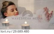 Купить «Woman taking bath in bathtub», видеоролик № 29689480, снято 26 августа 2016 г. (c) Wavebreak Media / Фотобанк Лори