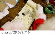 Купить «Santa claus reading a letter», видеоролик № 29689716, снято 6 июня 2016 г. (c) Wavebreak Media / Фотобанк Лори