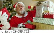 Купить «Santa claus holding various gift boxes», видеоролик № 29689732, снято 6 июня 2016 г. (c) Wavebreak Media / Фотобанк Лори