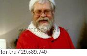Купить «Portrait of santa claus holding gift box», видеоролик № 29689740, снято 6 июня 2016 г. (c) Wavebreak Media / Фотобанк Лори