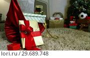 Купить «Close-up of sack and various gift boxes on rug», видеоролик № 29689748, снято 6 июня 2016 г. (c) Wavebreak Media / Фотобанк Лори