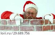 Купить «Santa claus climbing up a chimney», видеоролик № 29689756, снято 6 июня 2016 г. (c) Wavebreak Media / Фотобанк Лори