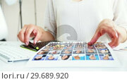 Купить «Graphic designer using a graphics tablet», видеоролик № 29689920, снято 1 сентября 2016 г. (c) Wavebreak Media / Фотобанк Лори