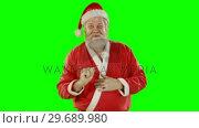 Купить «Santa claus using digital screen», видеоролик № 29689980, снято 7 сентября 2016 г. (c) Wavebreak Media / Фотобанк Лори