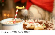 Купить «Christmas cookies on plate with a cup of milk», видеоролик № 29689992, снято 31 августа 2016 г. (c) Wavebreak Media / Фотобанк Лори