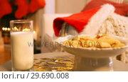 Купить «Christmas cookies on plate with a glass of milk», видеоролик № 29690008, снято 31 августа 2016 г. (c) Wavebreak Media / Фотобанк Лори